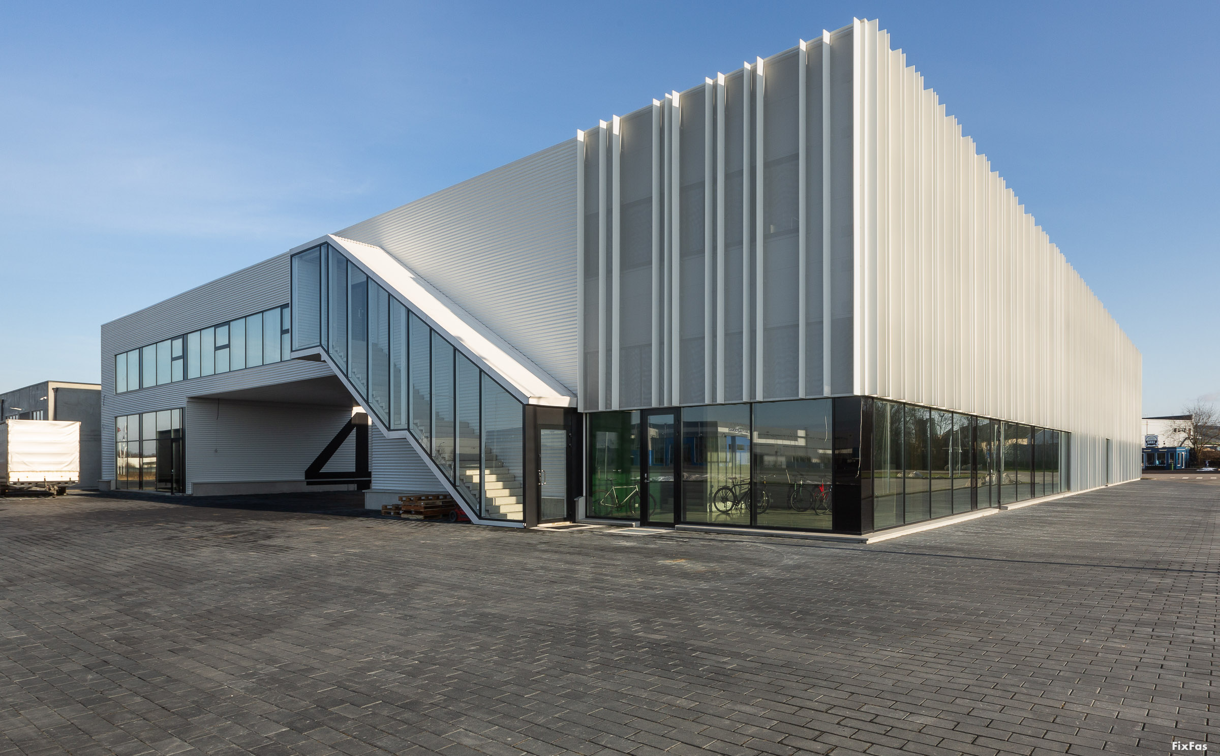 Warehouse with white fabric facade.